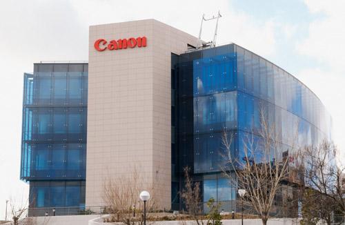 Canon reduce beneficios en los primeros seis meses del año