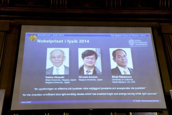 Japanese scientists Akasaki and Amano, and U.S. scientist Nakamura are seen on a screen after being announced as the 2014 Nobel Physics Laureates in Stockholm
