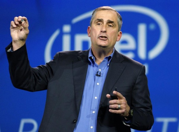 Krzanich, CEO of Intel, holds the button-sized Intel Curie module, at the International Consumer Electronics show in Las Vegas