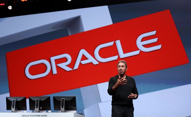 Oracle's Executive Chairman and Chief Technology Officer Larry Ellison gives the keynote address at Oracle OpenWorld in San Francisco, California, in this file photo taken September 30, 2014. Oracle Corp forecast quarterly profit below analysts' estimates and said weak sales of its traditional database software licenses were made worse by a strong U.S. Dollar that lowered the value of foreign revenue.  REUTERS/Robert Galbraith/Files