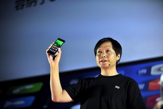 Lei Jun, CEO of Beijing Xiaomi Technology Co., Ltd. and Chairman of Kingsoft Co., Ltd., speaks holding a Xiaomi MI3 smartphone during a launch event for Xiaomis third Android phone, MI3, at Beijing International Convention Center in Beijing, China, 5 September 2013. Xiaomi announced its third Android phone, MI3, claiming its the fastest on the market. Its look is completely different from the former two Xiaomi phones but a lot like Nokia Lumia. Xiaomi sold 7.03 million phones, making a total of 13.27 billion yuan ($216 mn) in revenue in the first half of 2013. In 2012, a total of 7.9 million phones shipped that generated 12.6 billion yuan ($205 mn) in revenue for the company. Now Lei Jun, CEO of Xiaomi, sees the companys annual revenues reach 100 billion yuan ($16 bn) in 2015, no later than 2016.
